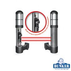 Carcasa Bunker tipo lámpara de guardia de  montaje de pared para alojar una fotocelda de doble haz infrarrojo.